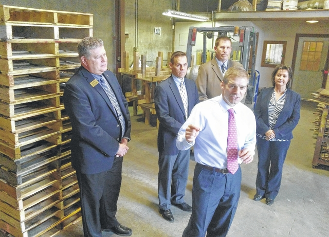 Pictured from left, Jed Metzger, CEO of the Lima-Allen County Chamber of Commerce; Jeff Sprague, CEO of the Allen Economic Development Group; Joe Patton, Workforce Development Administrator for Ohio Means Jobs-Allen County; and Tracie Sanchez, owner of Lima Pallet. Photo: The Lima News